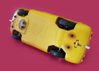 C57, yellow, small head, with lights - underpan showing holes for rubber lighting assembly